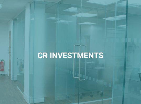 "Glass partitioning with blue overlay on image and text saying ""CR Investments"""