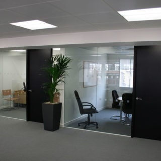 Offices with glass walls and black doors