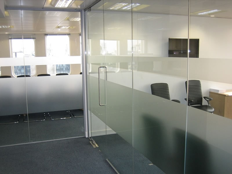 Glass partitioning to separate different office spaces