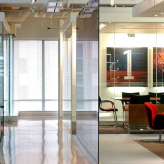 Glass partitions in a modern well lit office