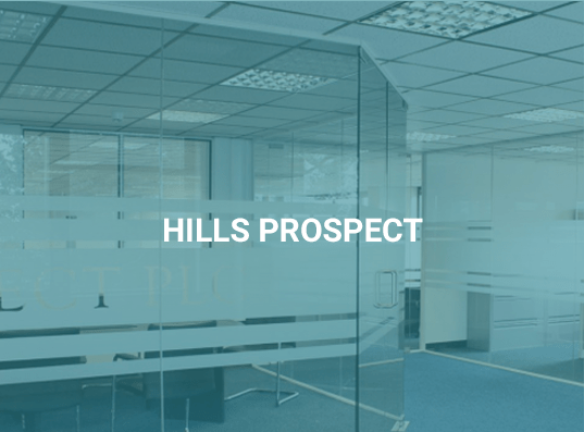"Glass partitioning with blue overlay on image and text saying ""Hills Prospect"""