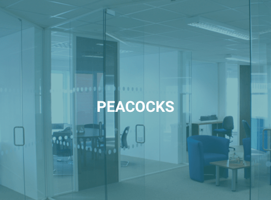 "Glass partitioning in an office with blue overlay on image and text saying ""Peacocks"""