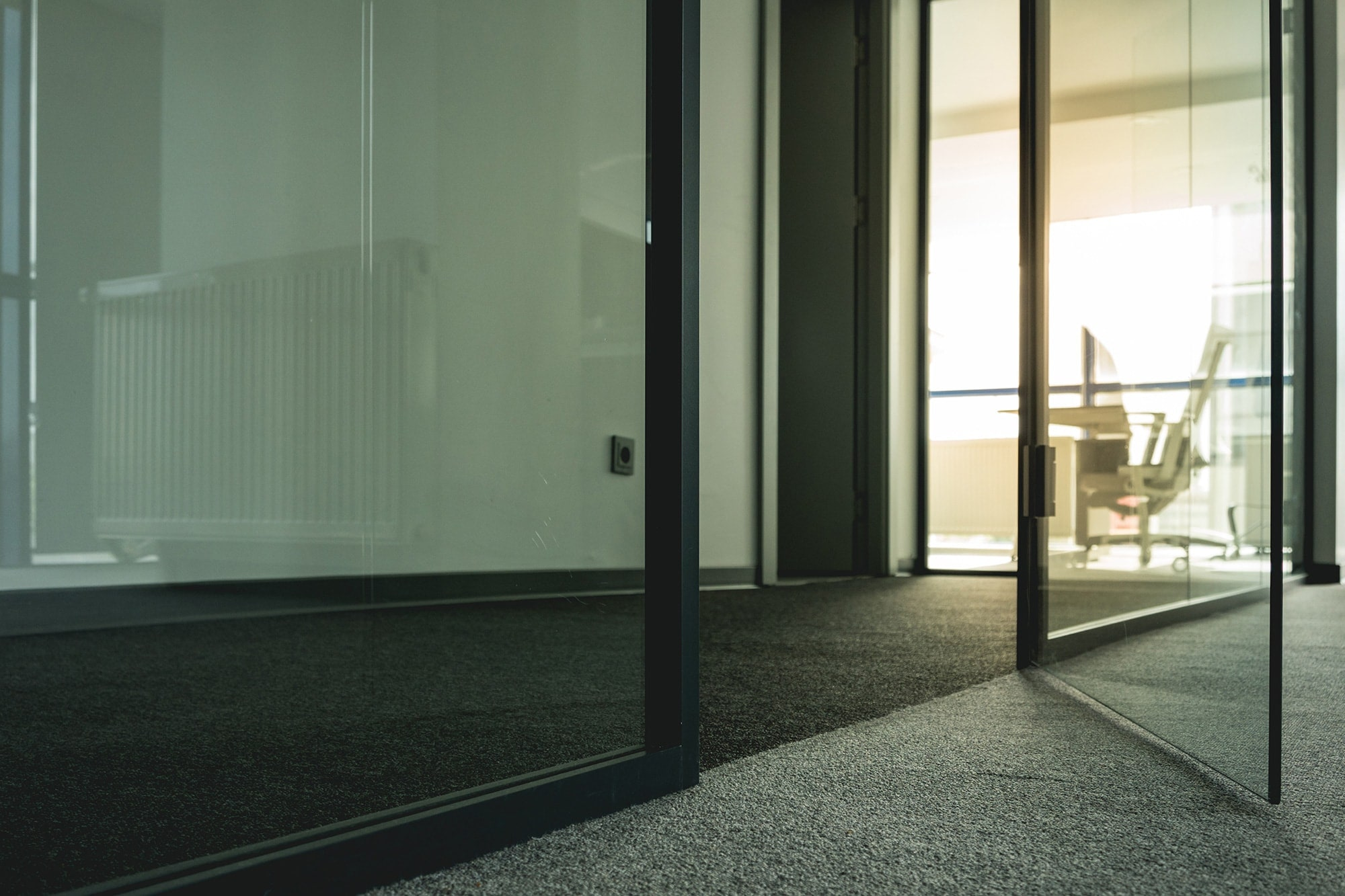 Glass partitioning door looking in to an office